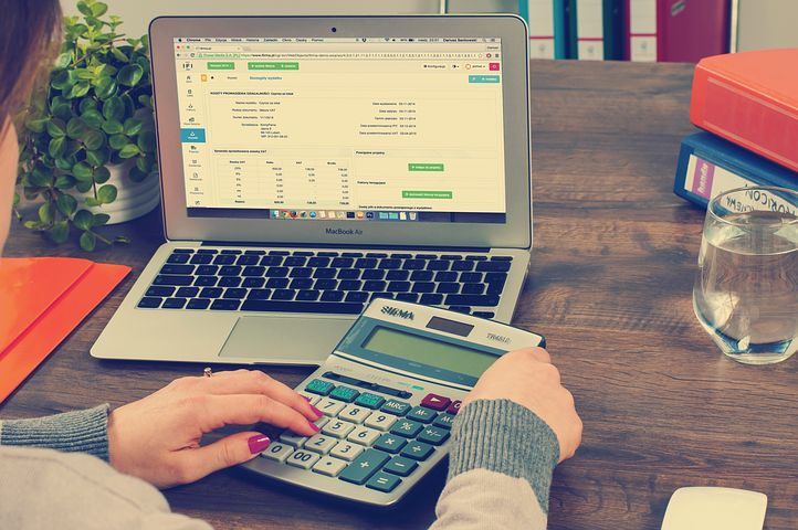 accountant computing with a calculator