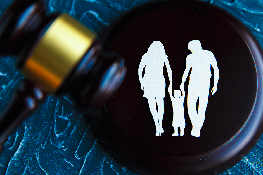 Cutout family imagery and a gavel. Child-custody and family law in Sydney concept.
