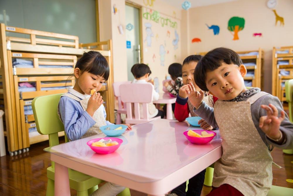 Kids inside a preschool in Delahey having some snacks