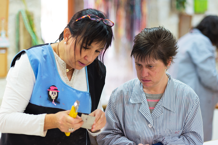 Occupational therapy NDIS support worker assisting a woman with disability