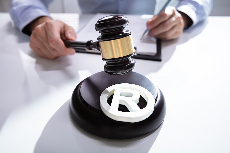 Trademark lawyer holding a gavel