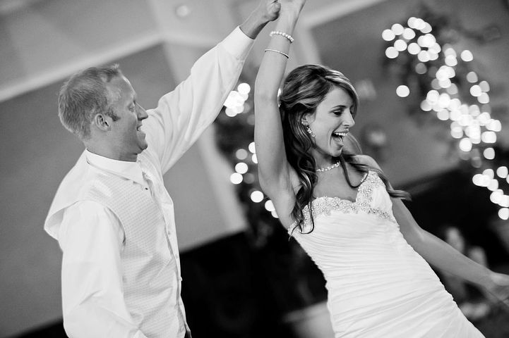 Bride and groom dancing in the reception